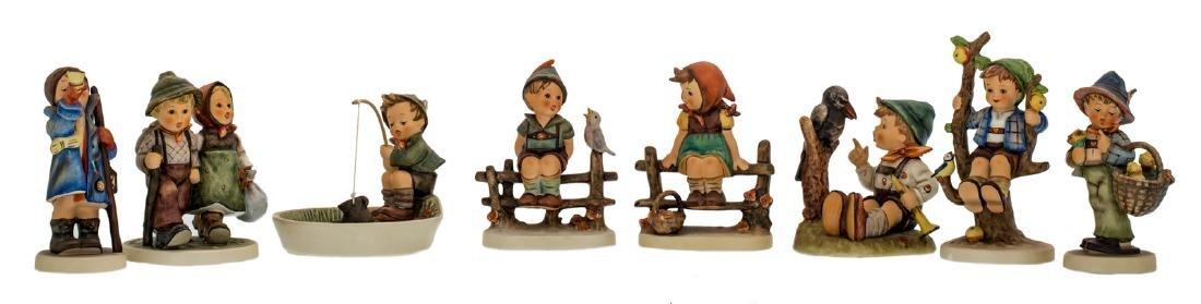 Eight Goebel and Hummel figurines, H 10 - 15 cm