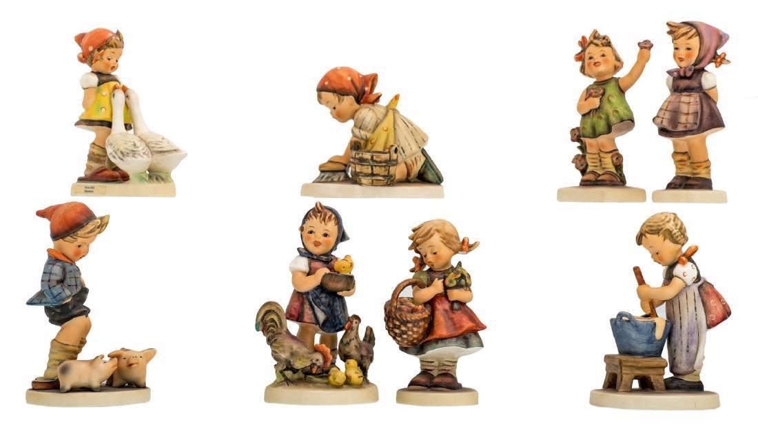 Eight Goebel and Hummel figurines, H 10 - 13,5 cm