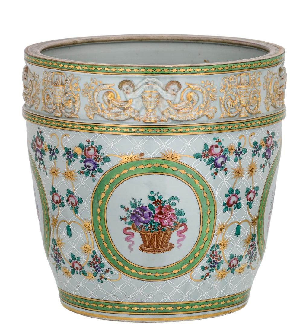 A polychrome decorated jardiniere with a chinoiserie