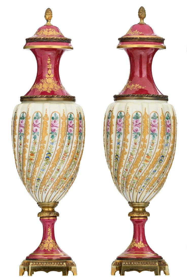 A pair of bronze mounted decorative vases in the Sevres