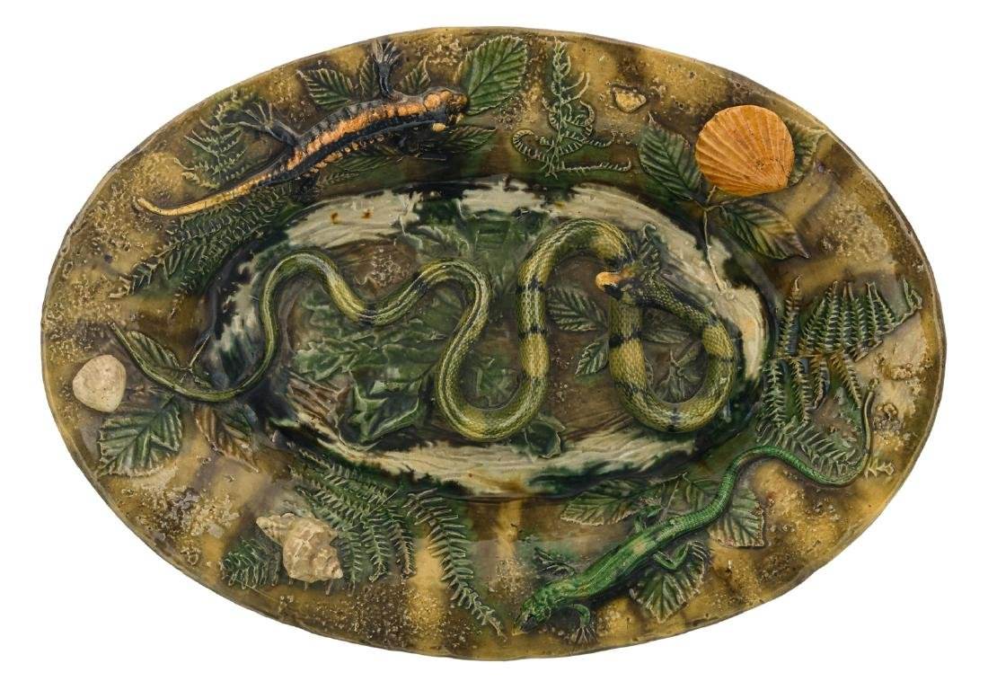 A polychrome and relief decorated earthenware plate in