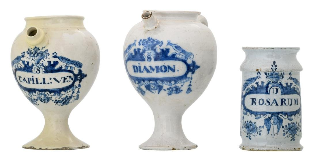 Two 18thC blue and white decorated syrup jars; added an
