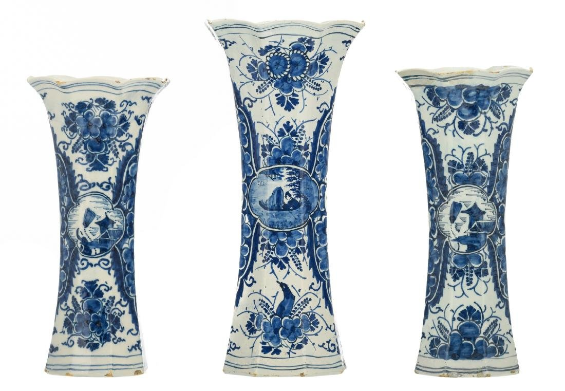 Three octagonal blue decorated vases in the Delft