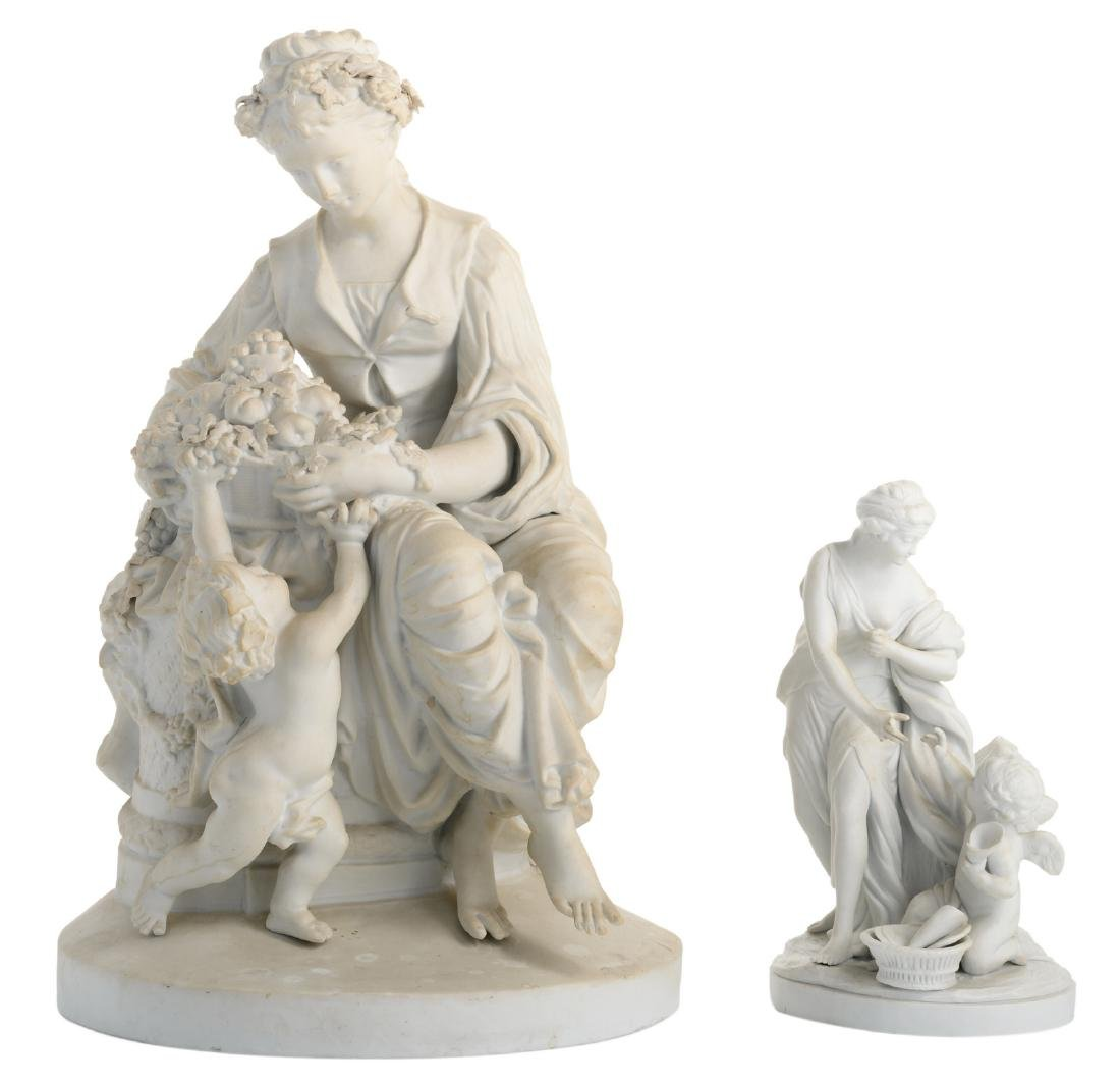 Two biscuit sculptures, one depicting mother and child