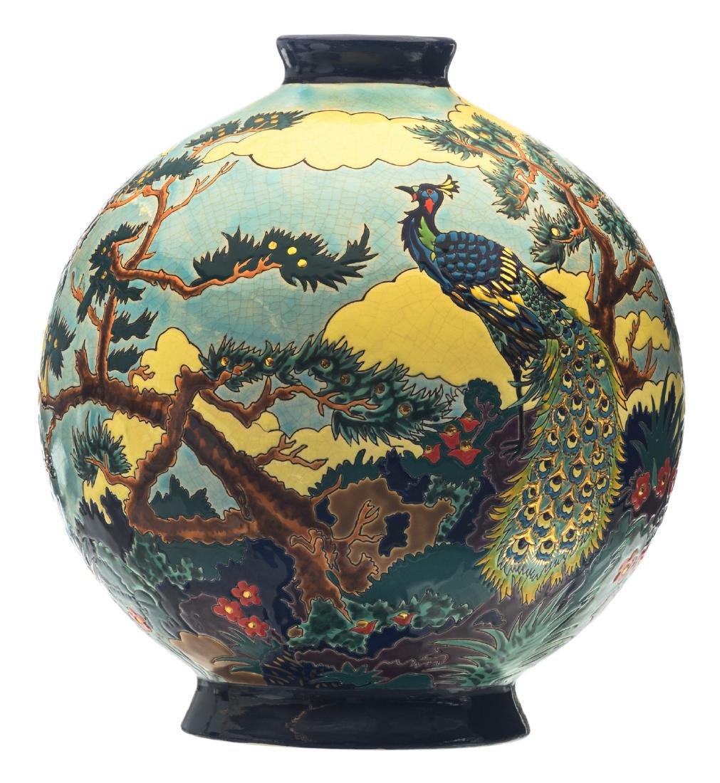 A decorative 'paon argente' Longwy vase, designed by