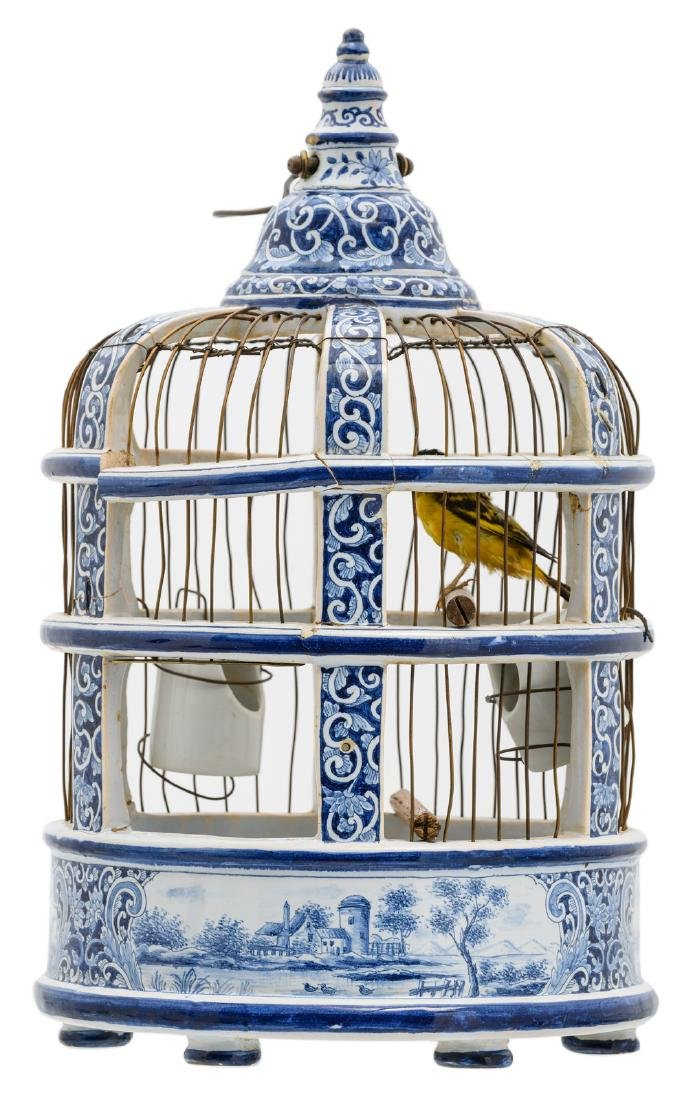 A 19thC Dutch blue and white birdcage with a stuffed