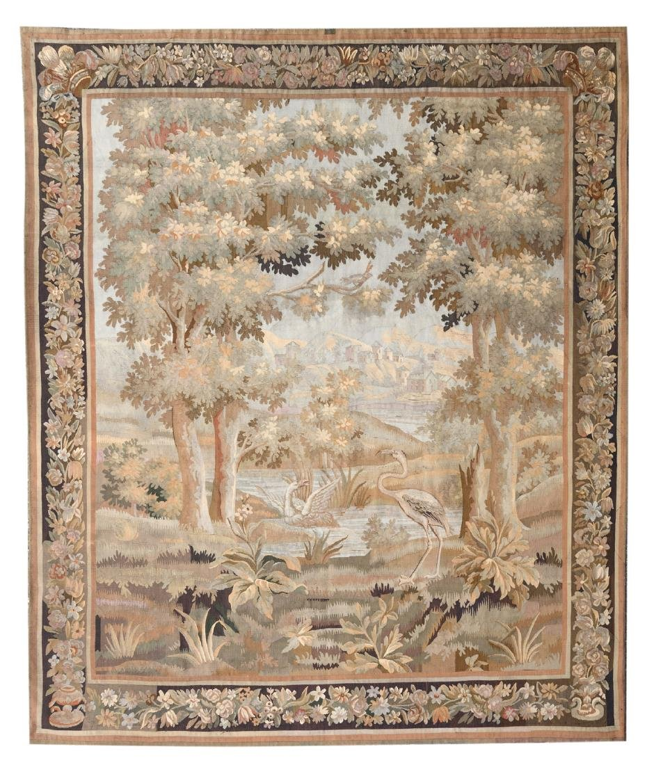 A Flemish or French wool and silk verdure tapestry in