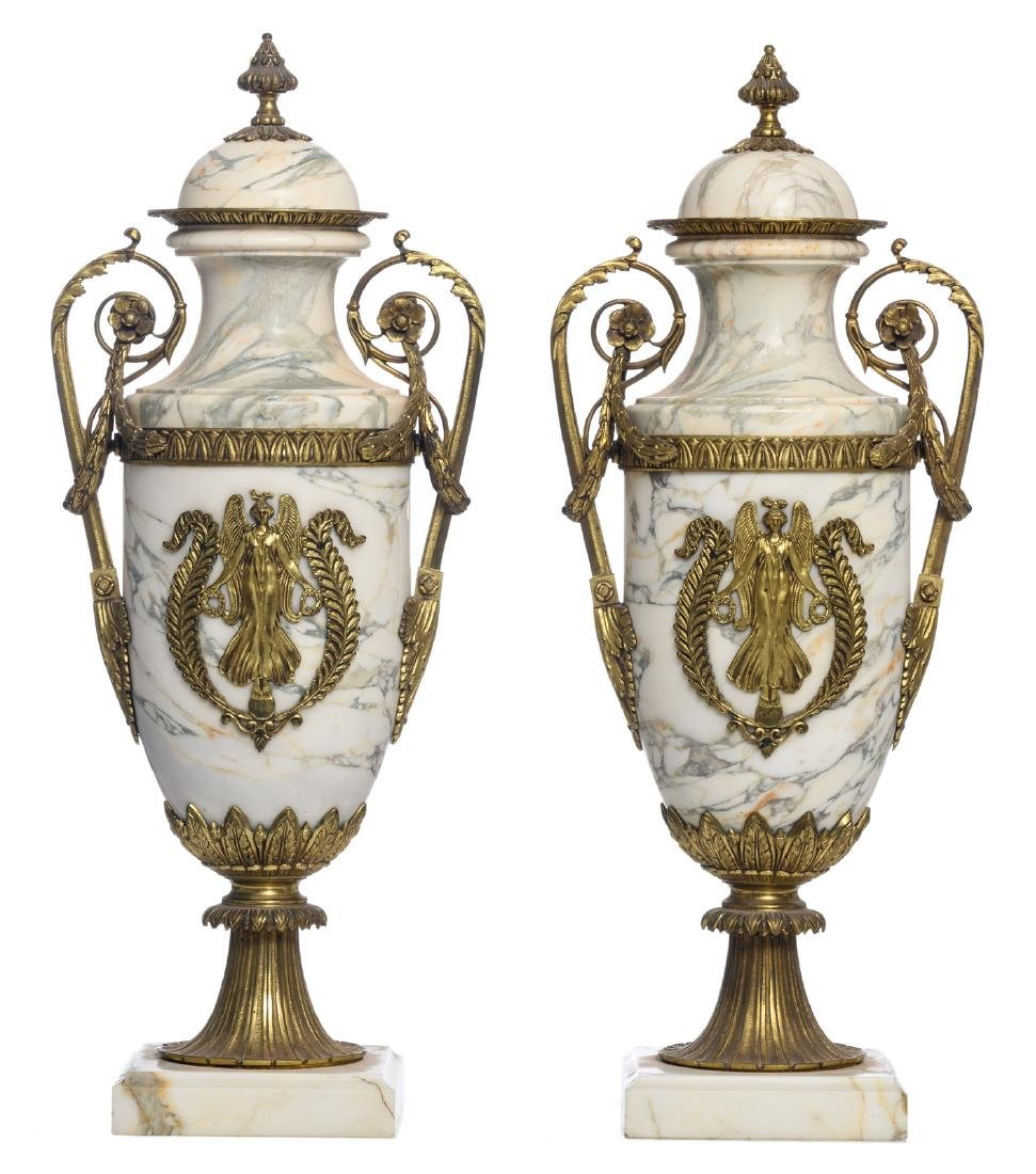 A pair of Neoclassical marble gilt bronze mounted