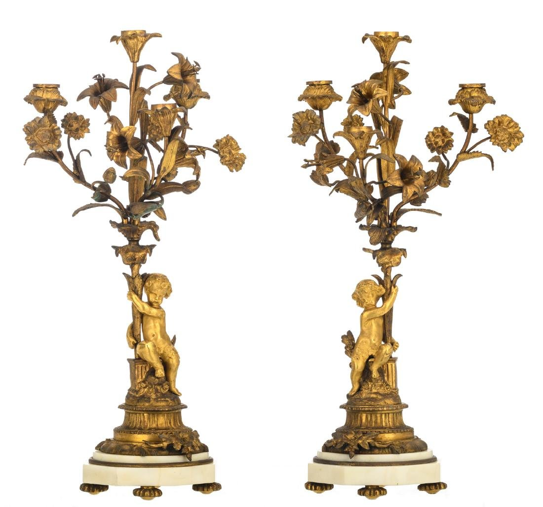 A pair of Historism gilt bronze candelabras with putti