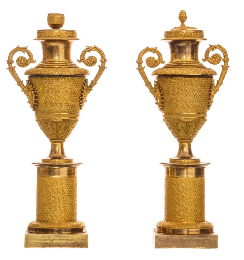 A pair of second quarter of the 19thC Neoclassical gilt