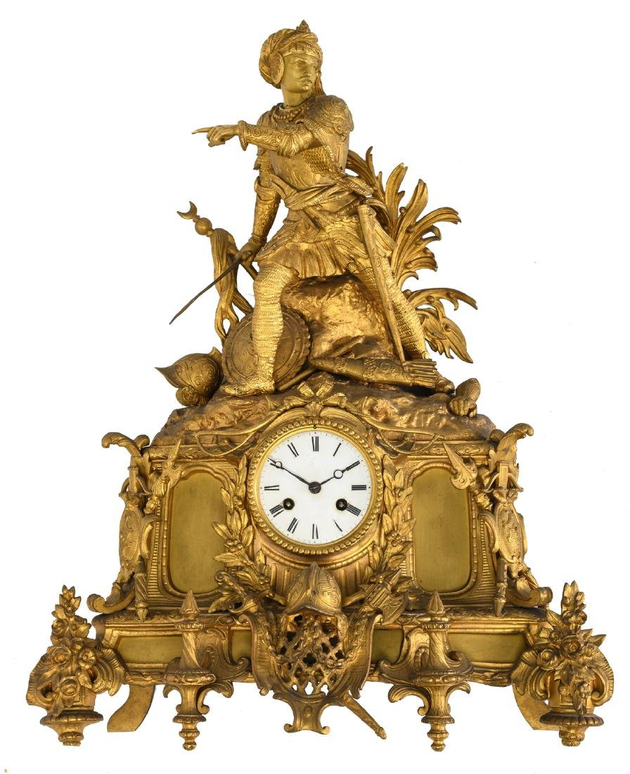 A Historism gilt bronze mantle clock crowned with a