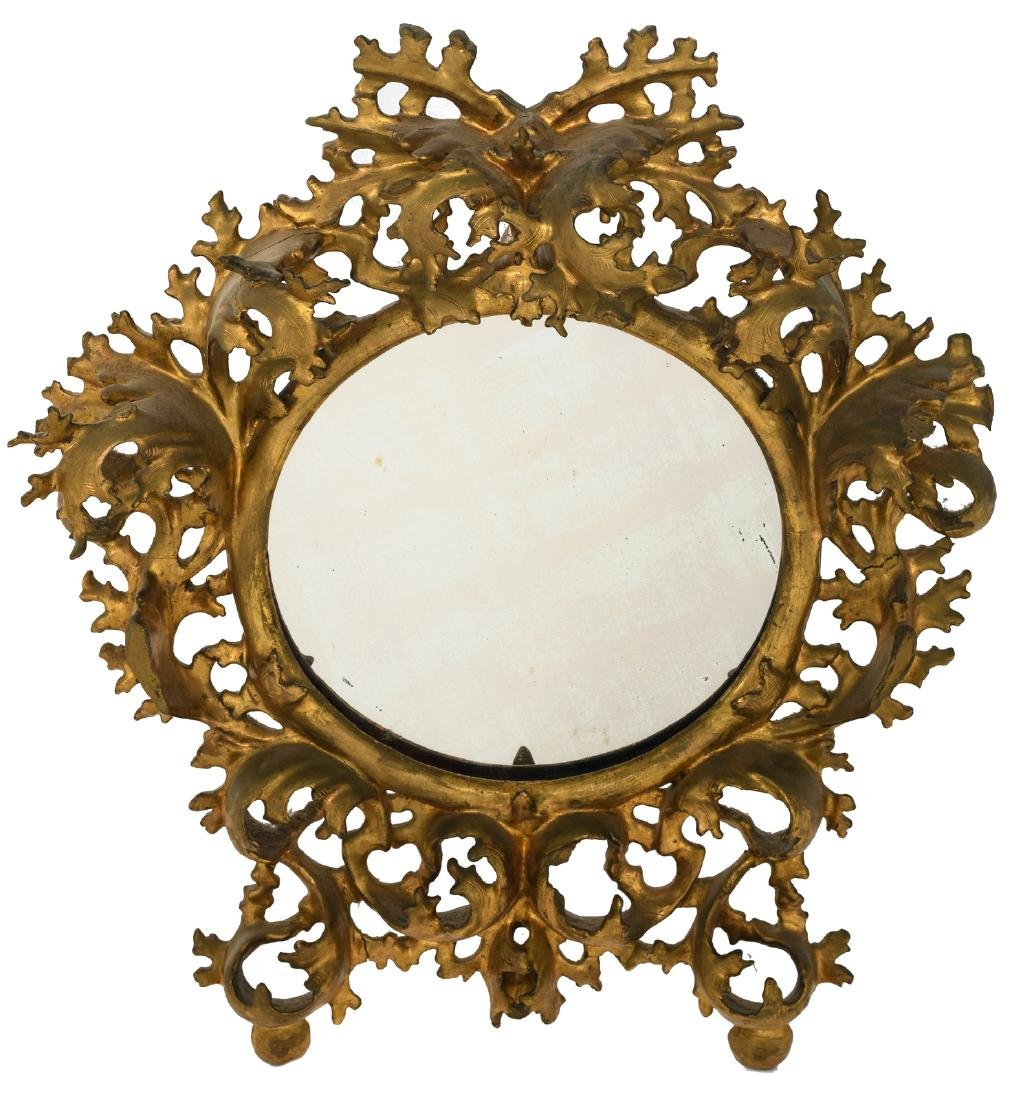 A mirror in an 18thC gilt wood Rococo style frame, H