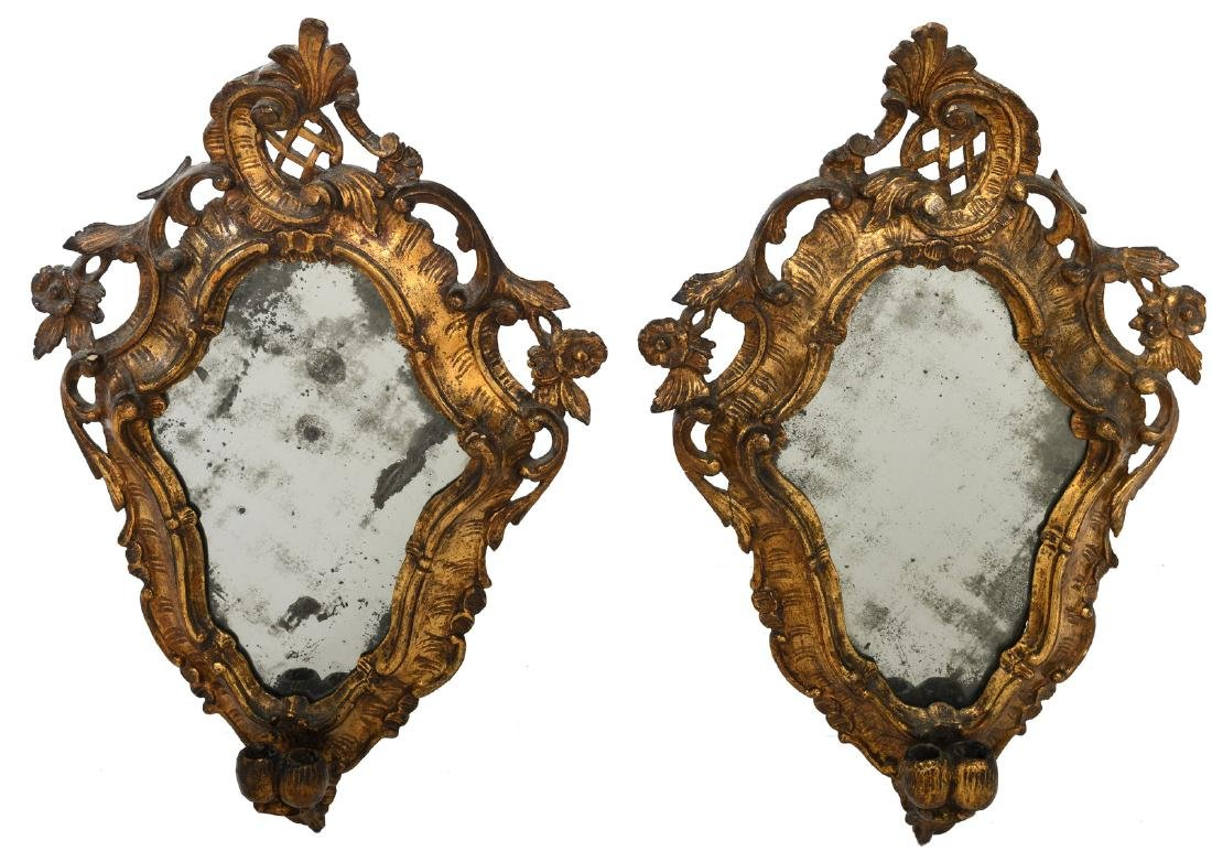 Two mirrors in a carved and gilt wood Rococo style