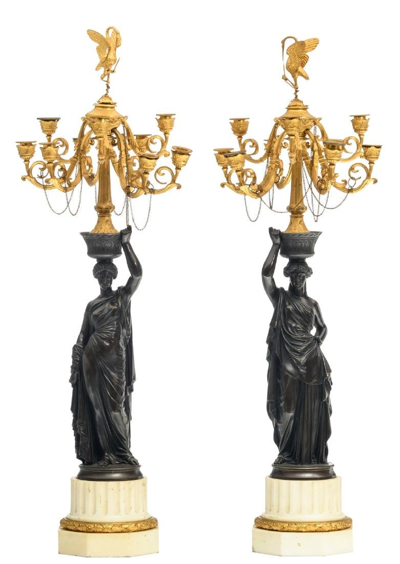 A pair of patinated and gilt bronze Historism