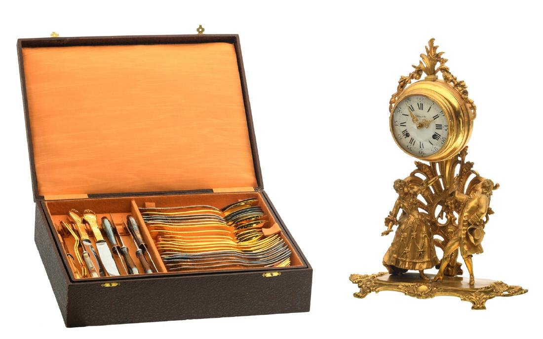 A Rococo style gilt bronze clock (Collection d'Arts);