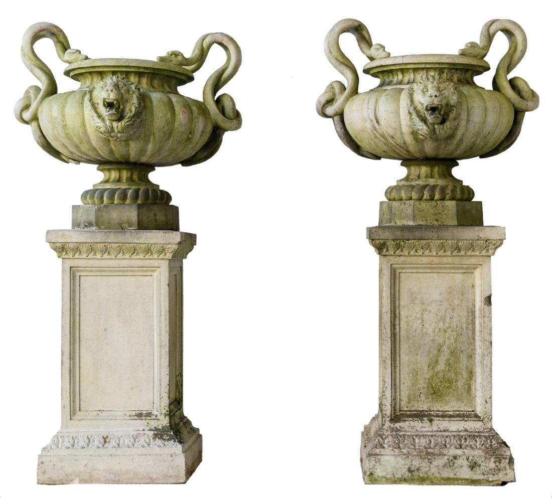 A pair of fine reconstituted stone garden vases on