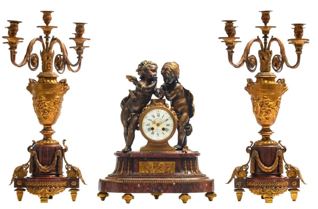 A 19thC Neoclassical gilt bronze mounted three-piece