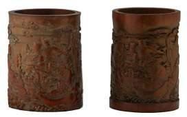 Two Chinese carved bamboo brushpots, depicting the