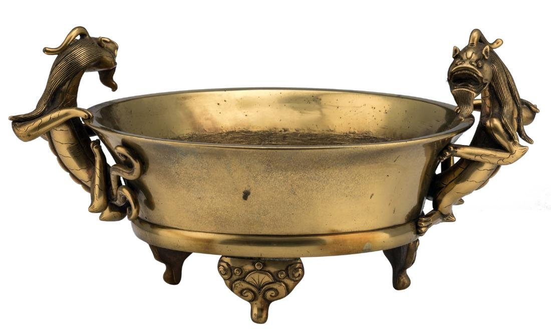 A Chinese tripod bronze incense burner, the handles