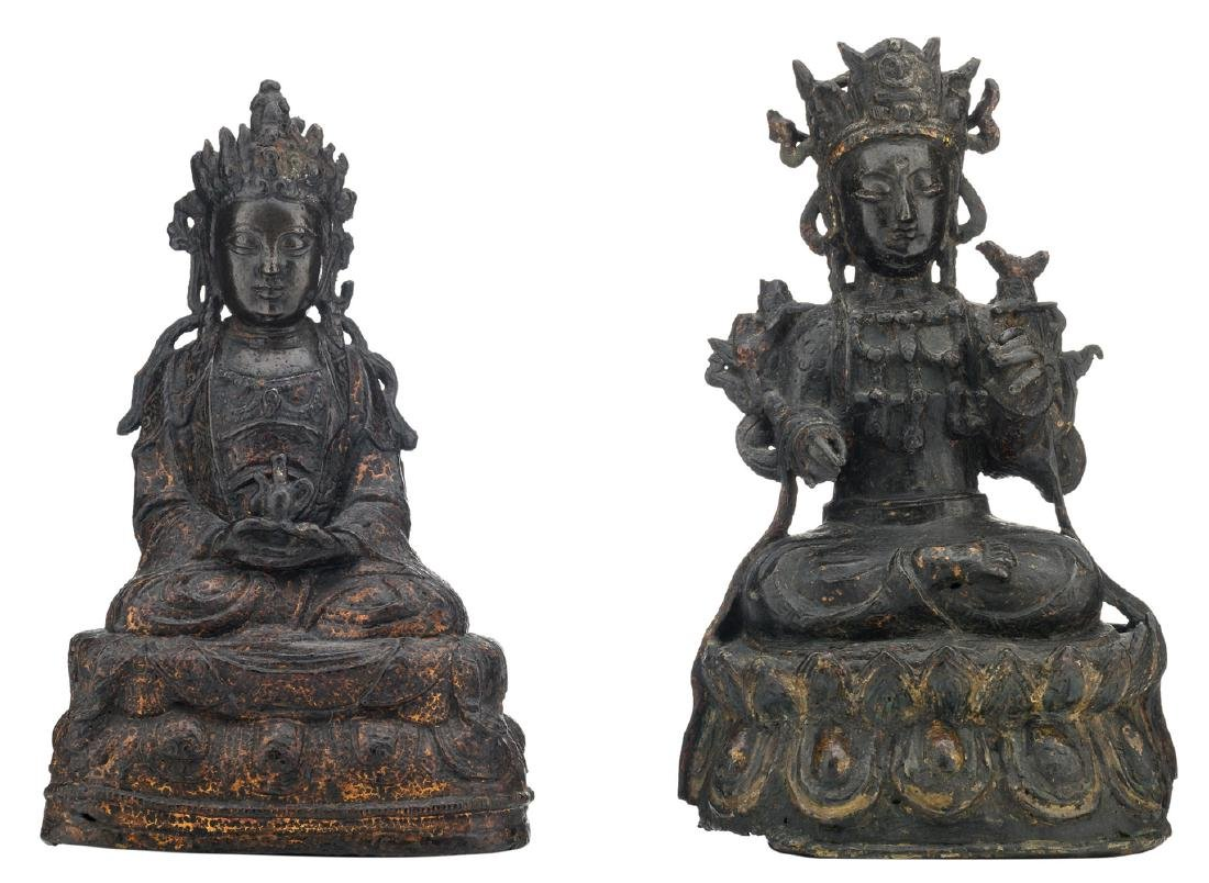 Two Chinese patinated bronze figures, depicting seated