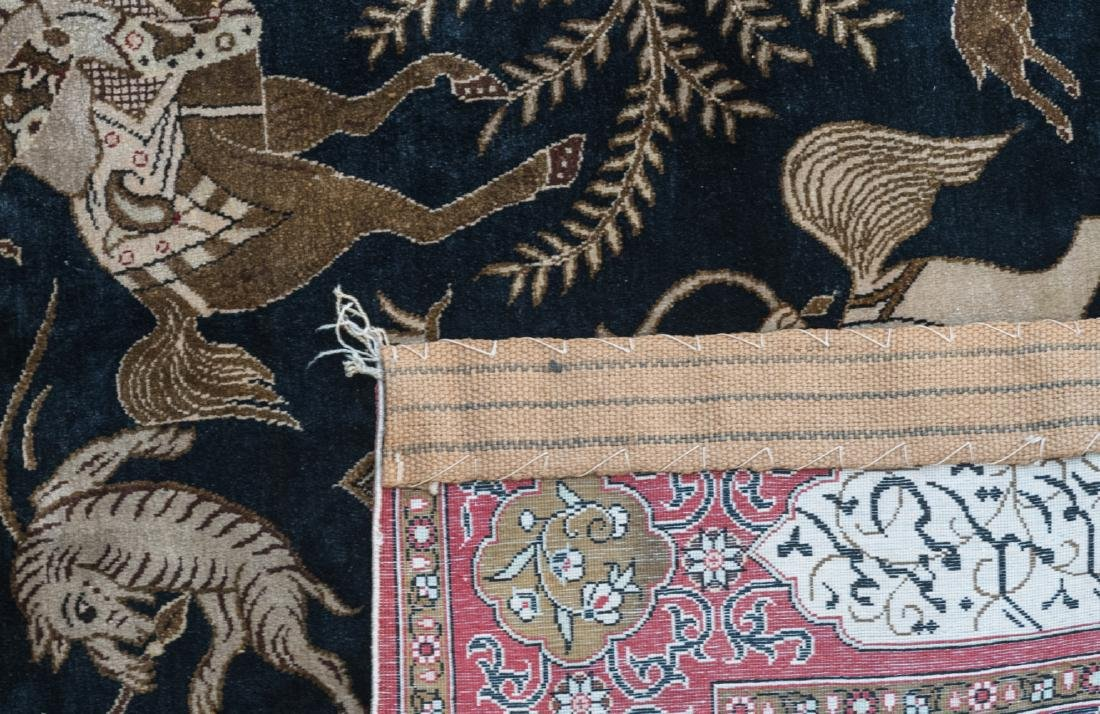 An Oriental silk carpet decorated with a hunting scene, - 3