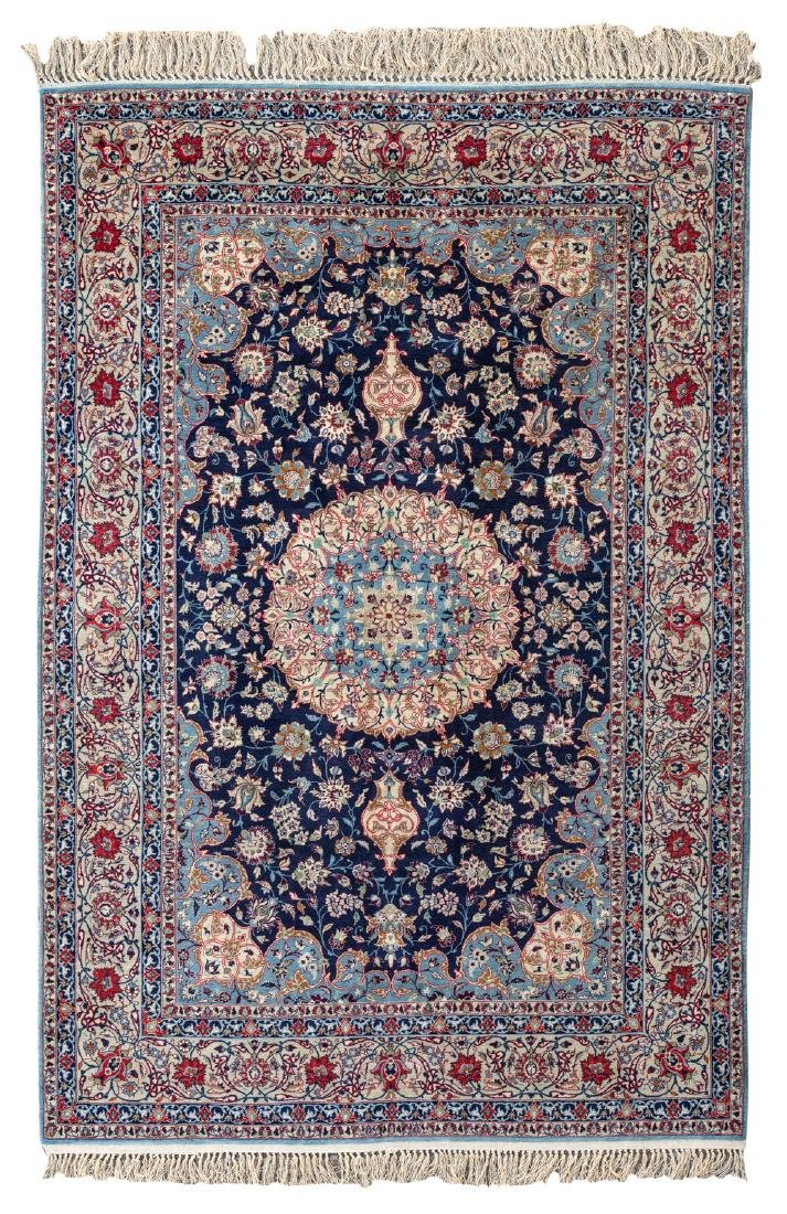 An Oriental silk rug with floral motifs and a central