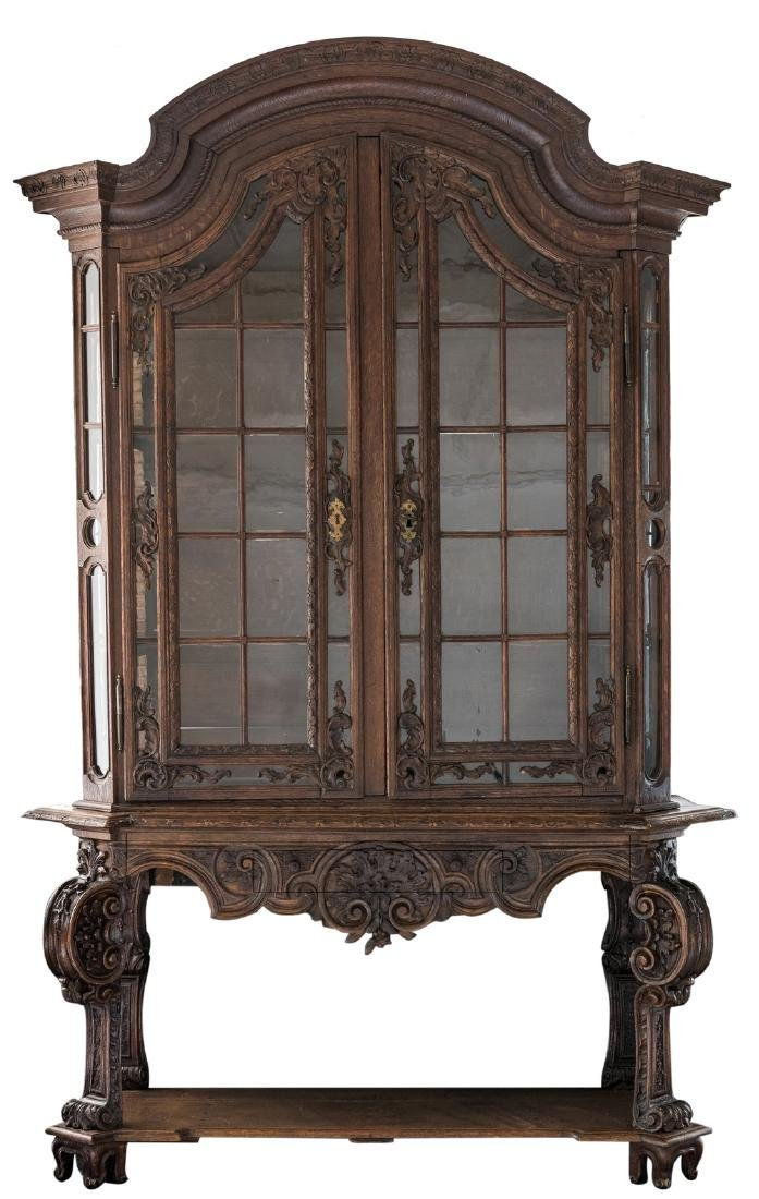 A fine carved late 19thC oak display cabinet in the