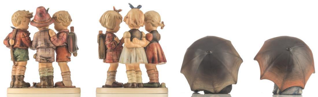The Goebel and Hummel umbrella boy and umbrella girl; - 2