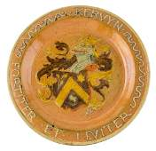 A Flemish earthenware dish in the Arts and Crafts