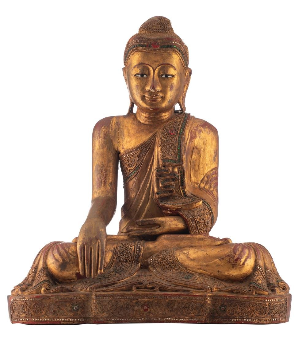 A Thai gilt lacquered wooden seated Buddha with glass