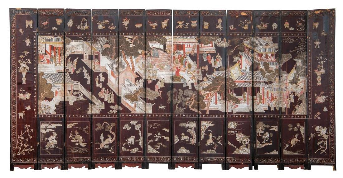 A Qing dynasty twelve panel coromandel lacquer screen