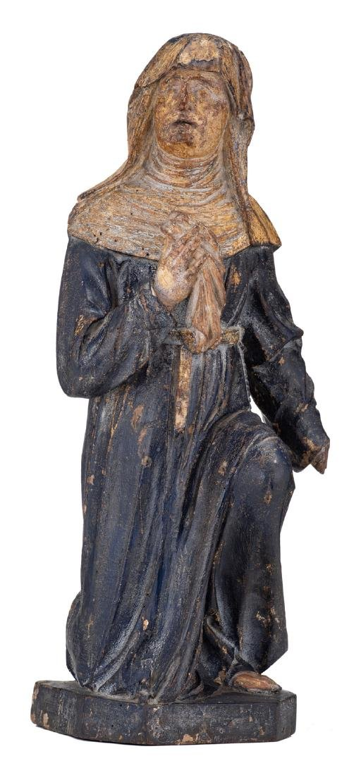 A religious wooden sculpture with polychrome paint and
