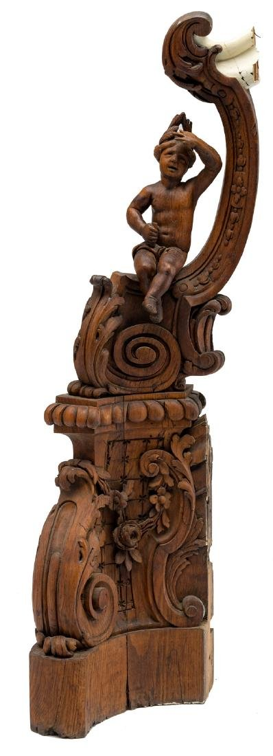 A sculpted oak, figural newel post, decorated with