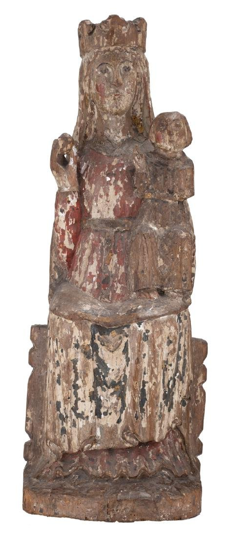 A religious wooden sculpture with  traces of