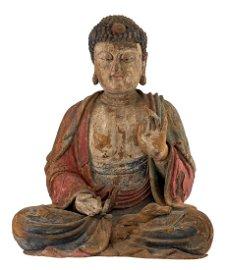 The Buddha, Shijiamuni (Sk. Sakyamuni), sits in