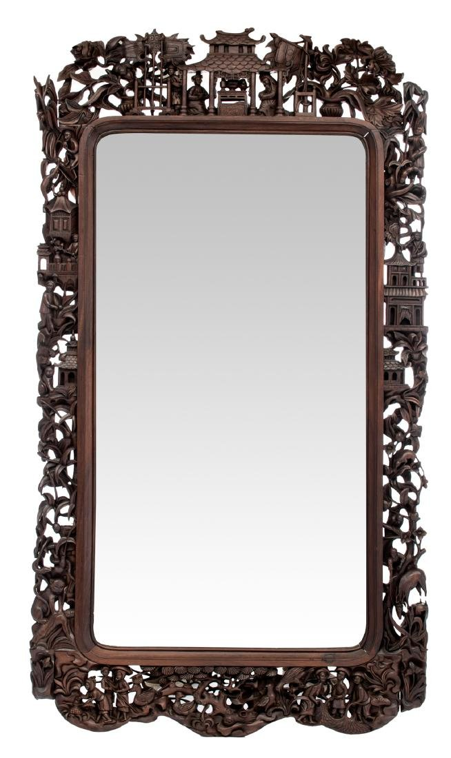 A Chinese richly carved wooden frame mirror, decorated