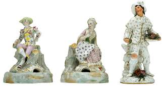 A pair of gallant figures in polychrome porcelain,