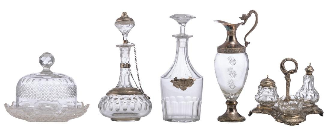 Two decanters and a pitcher (two of them with a silver