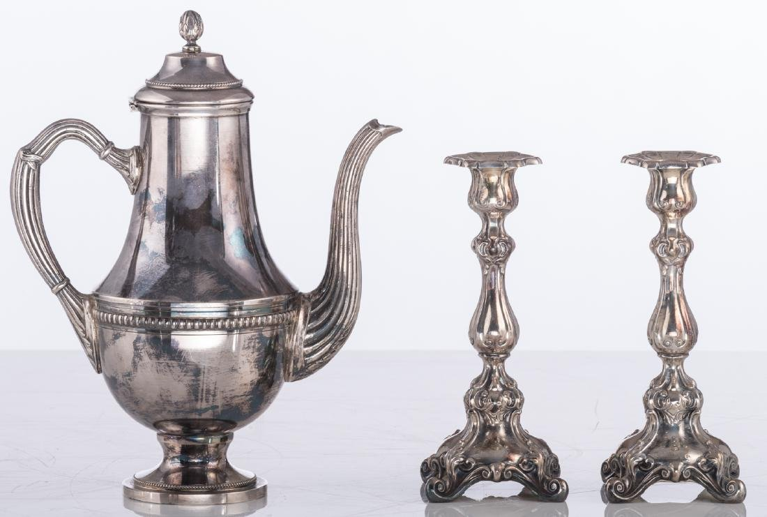 A pair of Regency style silver plated candlesticks; - 10
