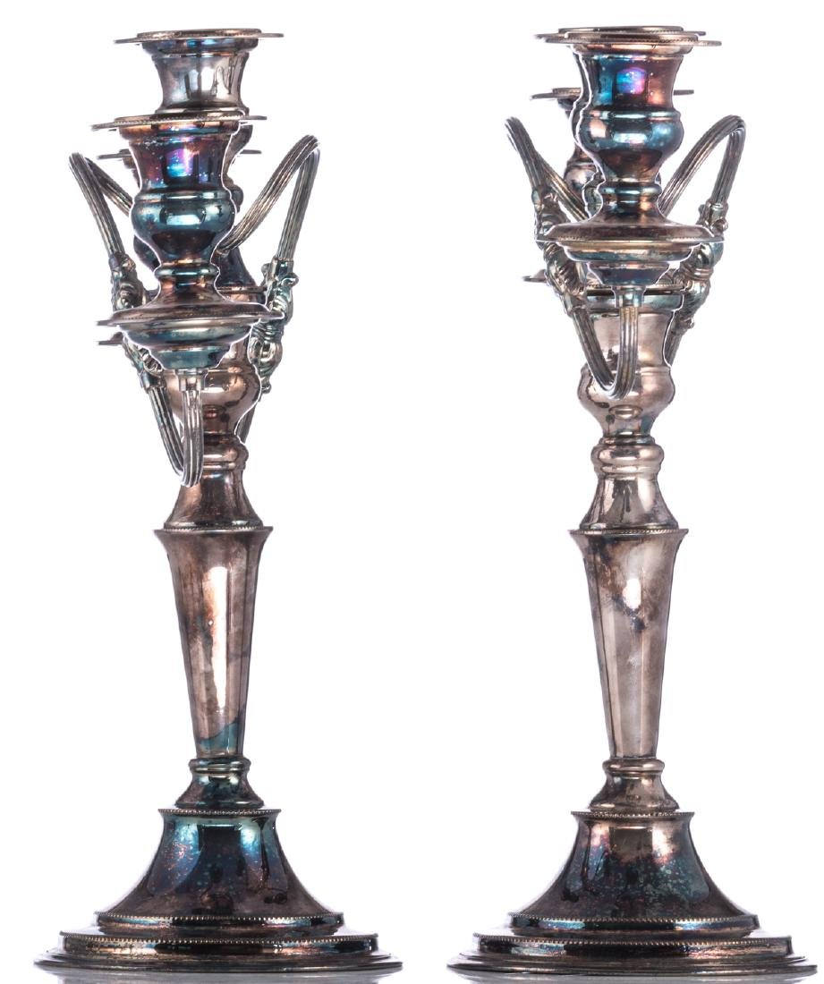 A pair of Regency style silver plated candlesticks; - 3