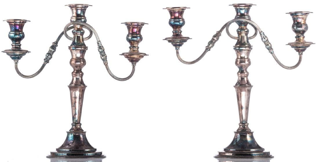 A pair of Regency style silver plated candlesticks; - 4