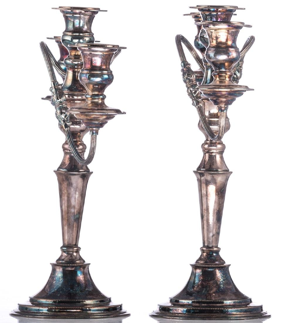 A pair of Regency style silver plated candlesticks; - 5
