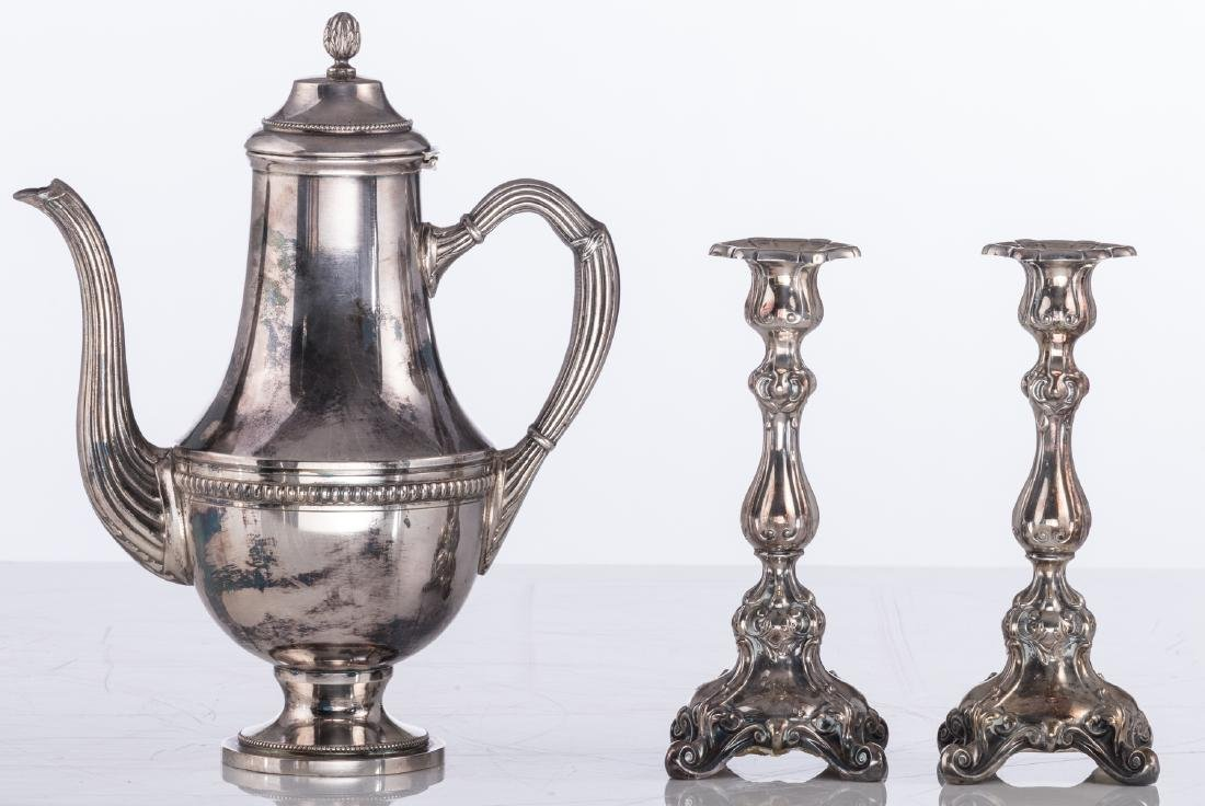 A pair of Regency style silver plated candlesticks; - 8