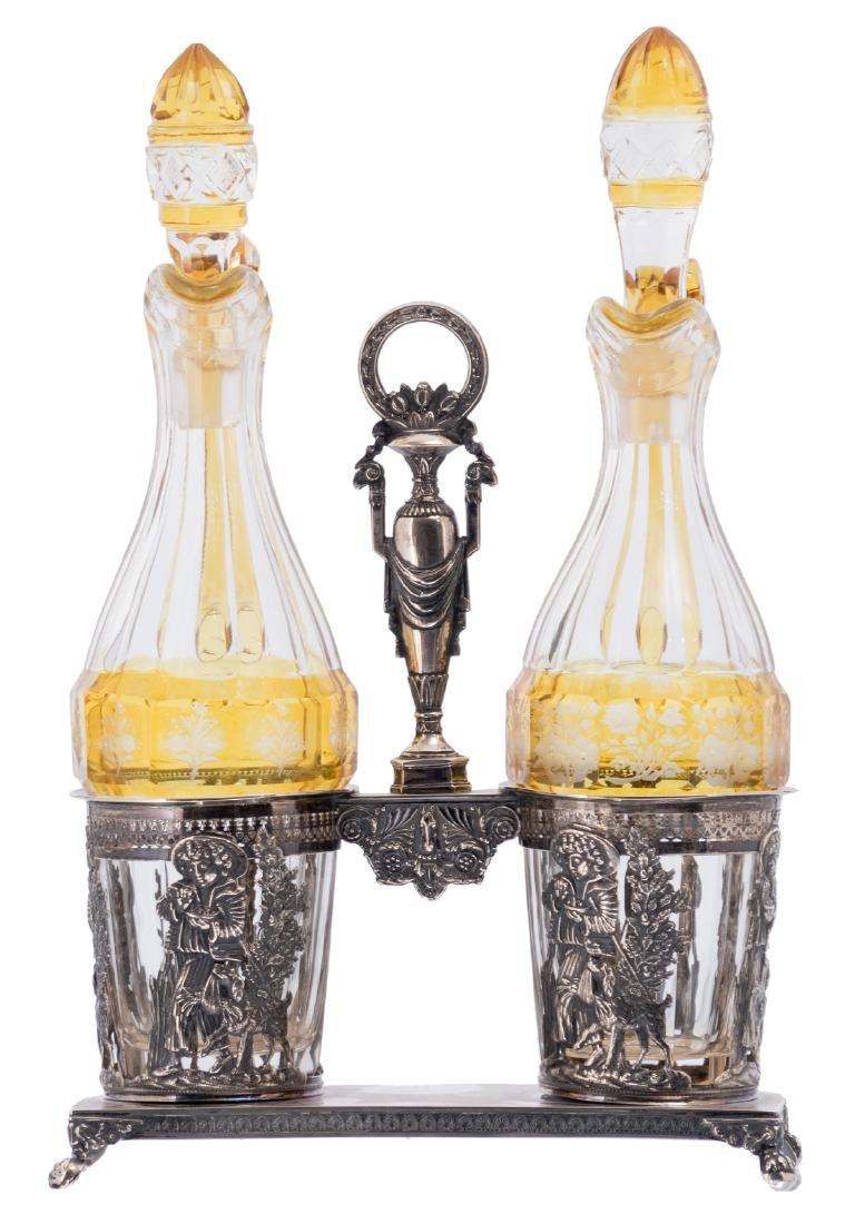 An Austro-Hungarian 19thC silver cruet set, the bottles