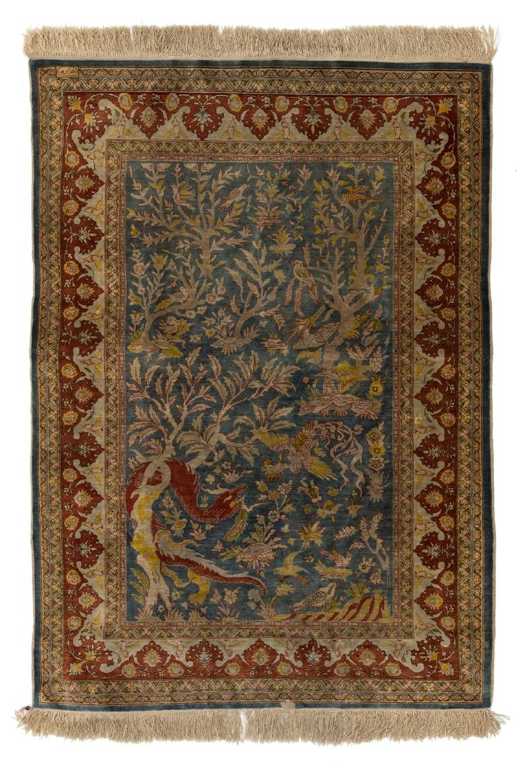 A fine Oriental silk rug, the field decorated with a