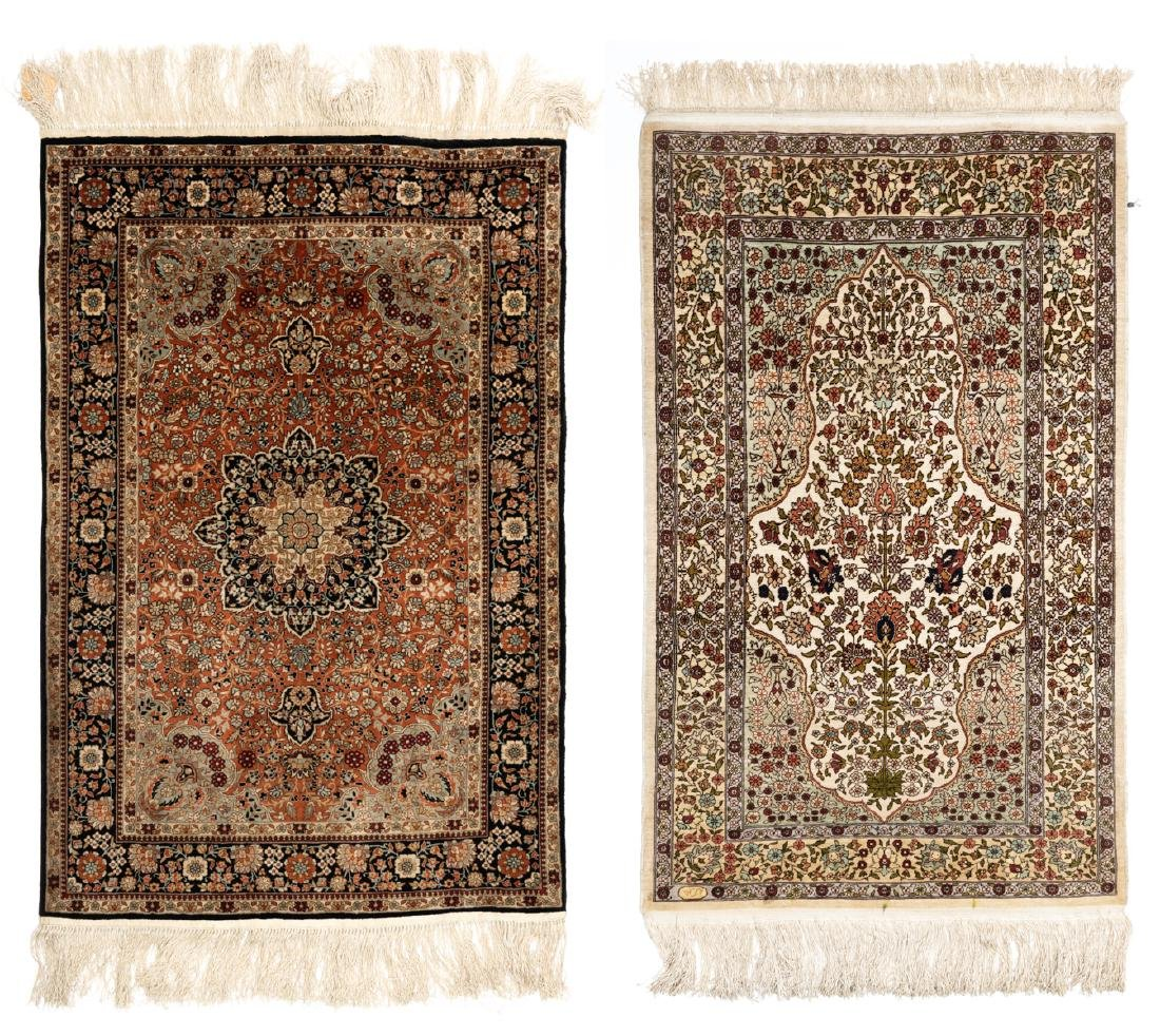Two Oriental floral decorated silk carpets, one carpet