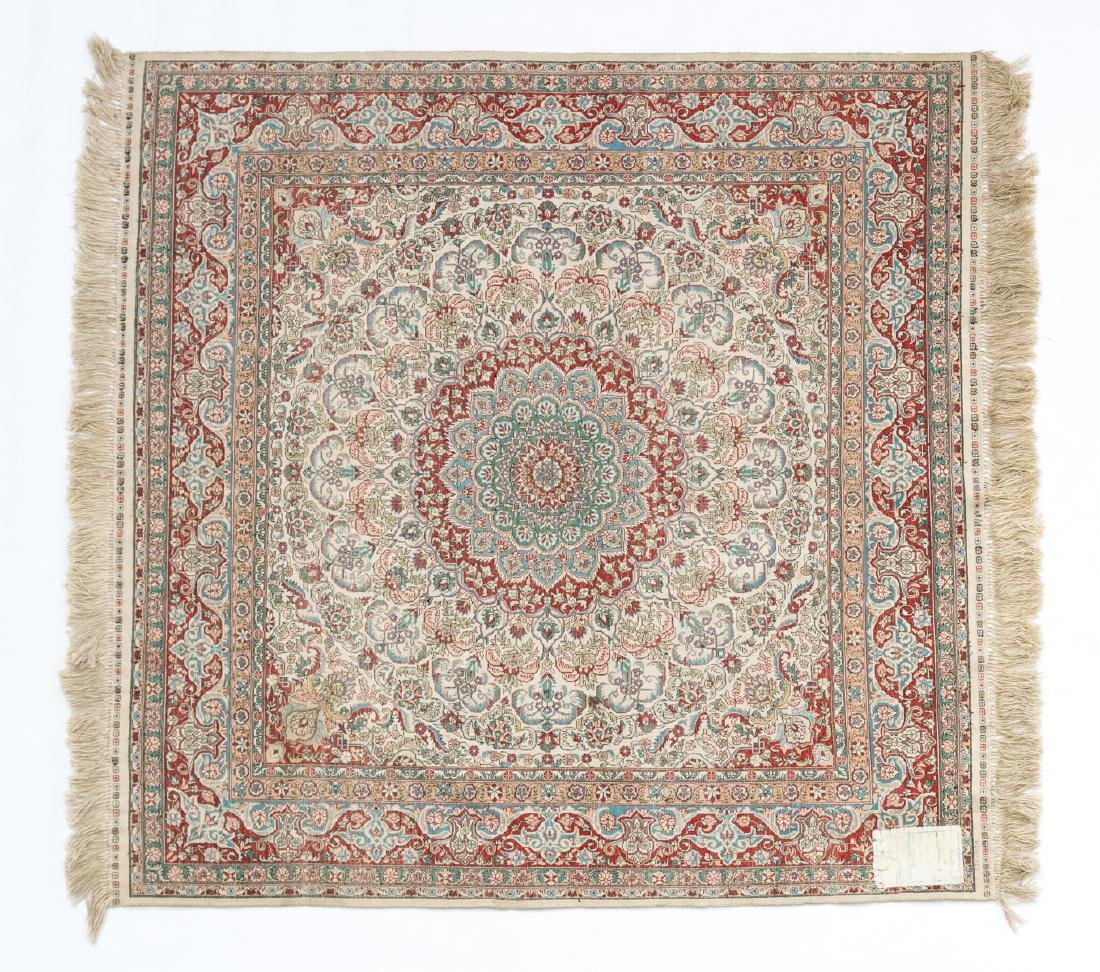 An Oriental square silk carpet with floral motifs and - 2