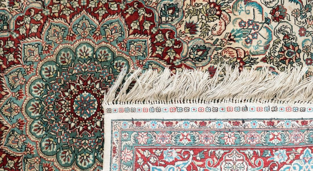 An Oriental square silk carpet with floral motifs and - 3