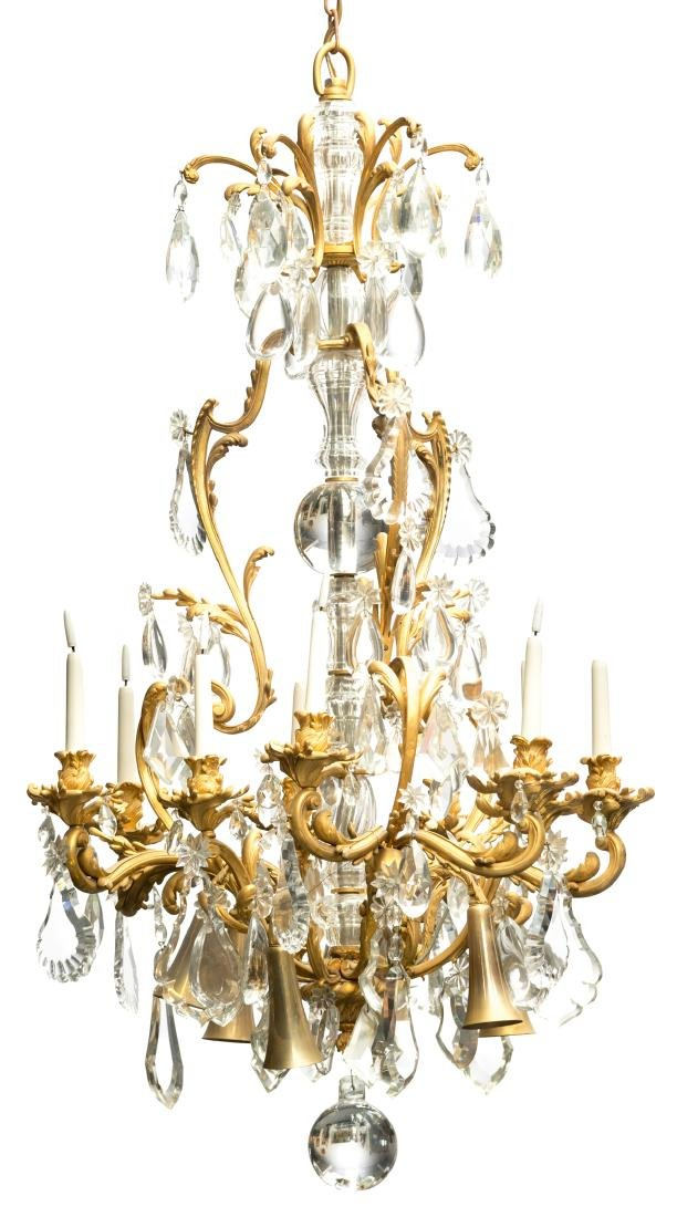 An imposing gilt bronze chandelier with crystal