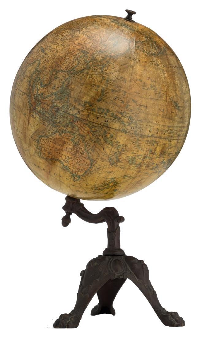 A terrestrial globe by J. Lebegue & Cie - Paris, on a